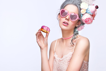 Photo for Beautiful blonde woman with a cake. Sweet sexy lady with heart glasses. Vintage style. Fashion photo - Royalty Free Image