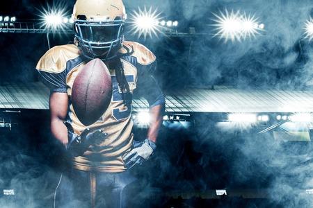 Foto de American football sportsman player on stadium running in action - Imagen libre de derechos