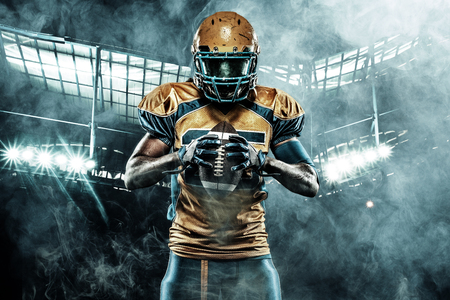 Photo pour American football sportsman player on stadium with lights on background - image libre de droit
