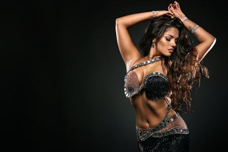Foto de Portrait of beautiful woman, traditional ballydance dancer. Ethnic dance. Belly dancing. Tribal dancing. - Imagen libre de derechos