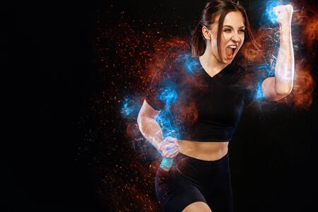 Photo for Sprinter and runner girl. Running concept. Fitness and sport motivation. Strong and fit athletic, woman sprinter or runner, running on black background in the fire wearing sportswear. - Royalty Free Image