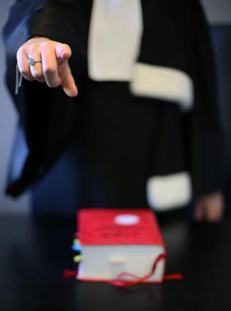 Photo pour Woman lawyer attorney wearing black gown - image libre de droit