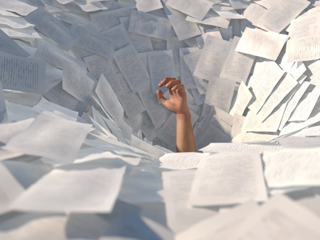 Photo pour hand drowning in paper sheets - image libre de droit