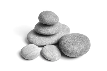 Foto de Group of smooth grey stones. Sea pebble. Stacked pebbles isolated on white background - Imagen libre de derechos