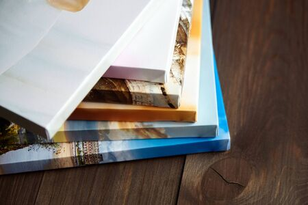 Photo for Photography canvas prints. Stacked colorful photos with gallery wrapping method of canvas stretching on stretcher bar, lateral side - Royalty Free Image