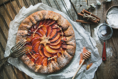 Photo for Galette with peaches on the old wooden background. Beautiful sweet cake background - Royalty Free Image