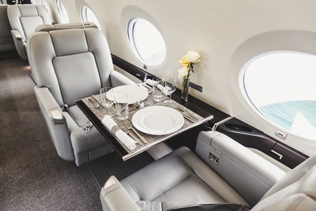 Photo pour Luxury interior in bright colors of genuine leather in the aircraft business aviation - image libre de droit