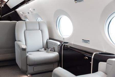 Foto de Luxury interior in bright colors of genuine leather in the business jet - Imagen libre de derechos