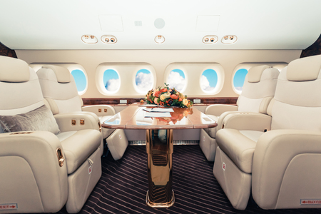 Photo pour Luxury interior in bright colors of genuine leather in the business jet - image libre de droit
