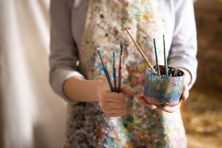 Photo for Closeup of female artist hand holding paintbrush - Royalty Free Image
