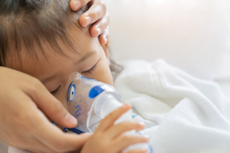 Photo pour Asian baby girl breathing treatment with mother take care, at room hospital, close up health care kid concept sunny light background. - image libre de droit