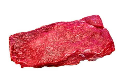 Photo pour The flat iron steak lies on a white background. Insulated - image libre de droit