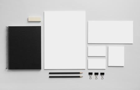 Foto de Mockup business brand template on gray background. Set of stationery with a black notepad. - Imagen libre de derechos