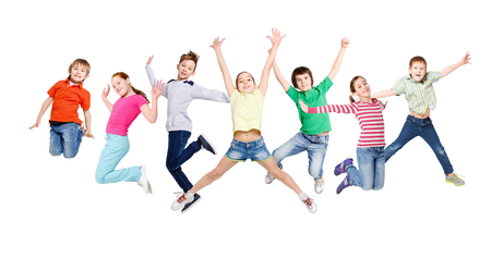 Foto de Group of happy, cheerful children jumping at isolated white studio background. Childhood and freedom, active lifestyle concept, copy space - Imagen libre de derechos