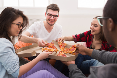 Photo for Pizza delivery. Happy people eating lunch at coworking office during break, crop, closeup - Royalty Free Image