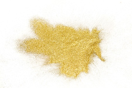 Photo pour Golden glitter sand texture, handful spread on white, abstract background with copy space, top view. Yellow dusty shimmer decoration pile, shiny and sparkling. Holiday and glamour concept. - image libre de droit