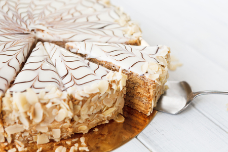 Photo for Closeup of sliced esterhazy cake. Delicatessen sweet dessert with almond meringue dough and buttercream, traditional hungarian, austrian cuisine. - Royalty Free Image