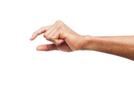 Photo for Black male hand measuring invisible items, mans palm making gesture while showing small amount of something on white isolated background - Royalty Free Image