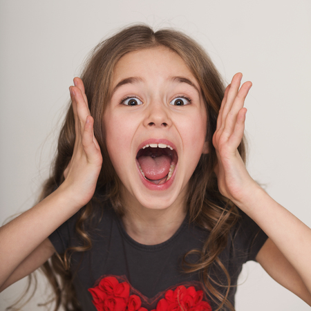 Photo for Children bad behavior. Emotional screaming excited little girl portrait - Royalty Free Image