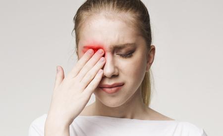 Foto de Upset woman suffering from strong eye pain. Healthcare concept, panorama - Imagen libre de derechos