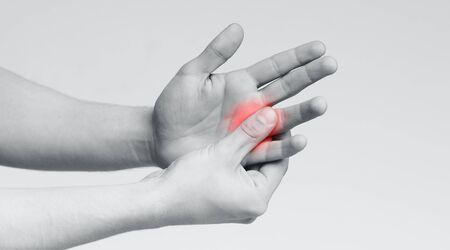Foto de Pain and numbness in fingertips and palms. Man massaging his sore hand, panorama - Imagen libre de derechos