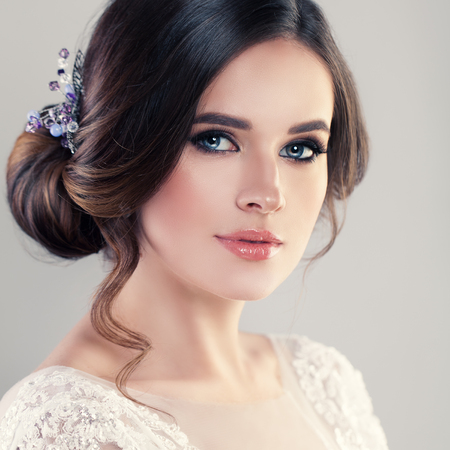 Photo pour Young Woman Fiancee with Bridal Hairstyle, Natural Makeup and Jewelry - image libre de droit