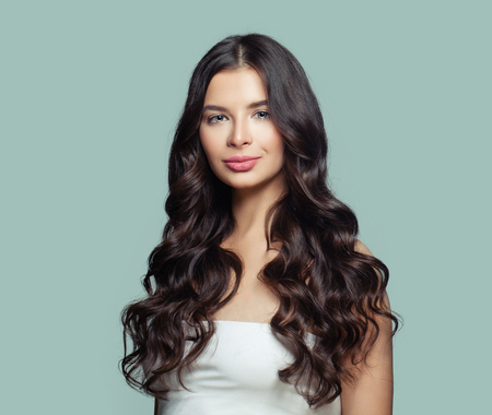 Photo for Healthy hair woman. Perfect girl with long curly hairstyle. Hair care concept - Royalty Free Image