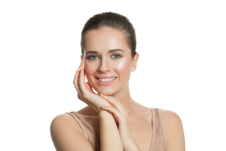 Foto de Pretty young woman with natural perfect clear skin isolated on white. Skincare and facial treatment concept - Imagen libre de derechos