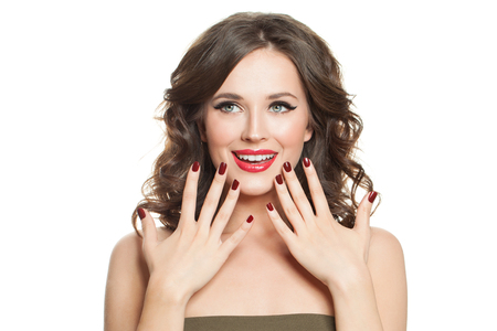 Photo for Cheerful woman with makeup and red nails manicure isolated on white background - Royalty Free Image