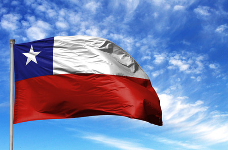Photo pour National flag of Chile on a flagpole in front of blue sky. - image libre de droit
