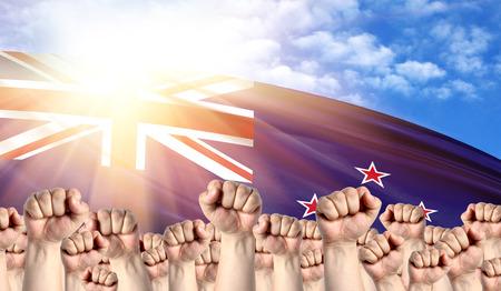 Photo pour Labor Day concept with fists of men against the background of the flag of New Zealand - image libre de droit