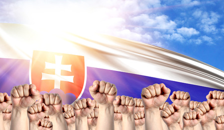 Photo pour Labor Day concept with fists of men against the background of the flag of Slovakia - image libre de droit