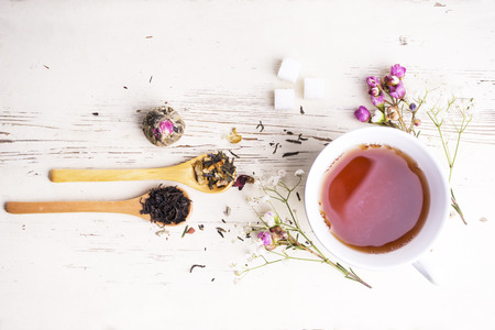 Photo for A cup of tea with flowers and tea around it - Royalty Free Image