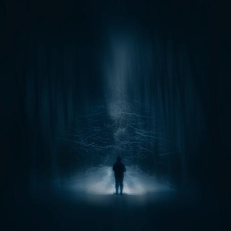 Photo pour Surreal night forest landscape with alone strange man with flashlight. Horror scene. - image libre de droit