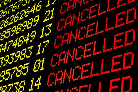 Photo pour Cancelled flights on airport board panel - image libre de droit