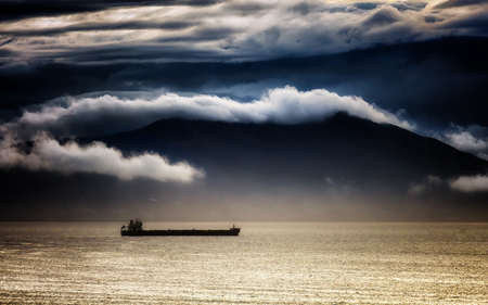 Foto per cargo ship with stormy weather on the sea - Immagine Royalty Free