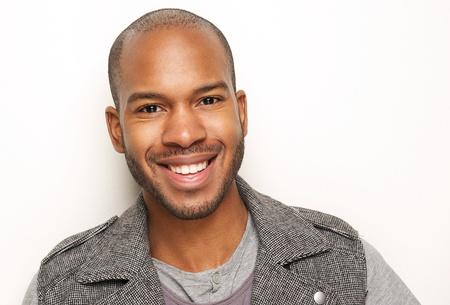 Photo pour Close up portrait of a handsome young man smiling - image libre de droit