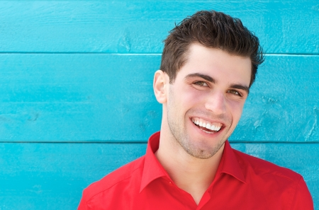 Photo for Close up horizontal portrait of a happy smiling young man - Royalty Free Image