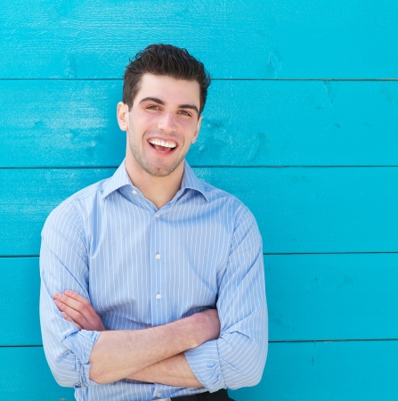 Photo for Closeup portrait of an attractive male model laughing outdoors - Royalty Free Image