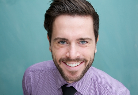 Photo for Closeup portrait of an attractive young business man smiling - Royalty Free Image