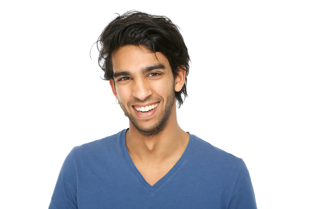 Photo pour Close up portrait of a handsome young indian man smiling on isolated white background - image libre de droit