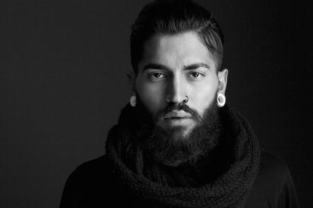 Photo pour Black and white close up portrait male fashion model with beard and piercing - image libre de droit