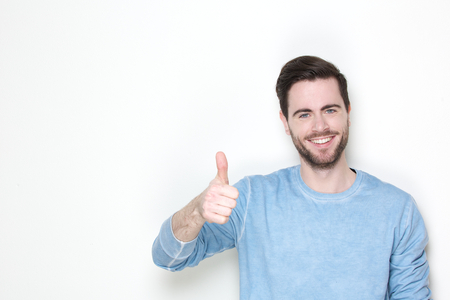 Photo for Portrait of a cheerful man posing with thumbs up sign - Royalty Free Image