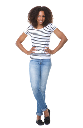 Photo pour Full body portrait of an attractive young black woman smiling on isolated white background - image libre de droit
