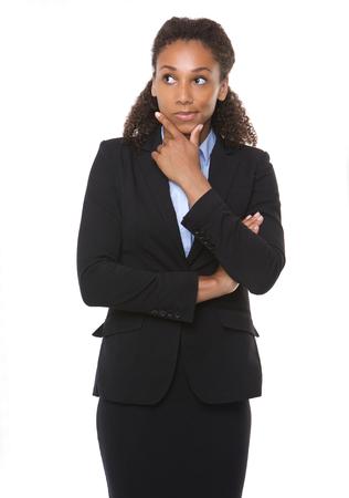 Foto de Portrait of a young business woman thinking on isolated white background - Imagen libre de derechos