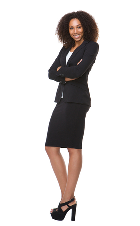 Full length portrait of an african american business woman smiling on isolated white