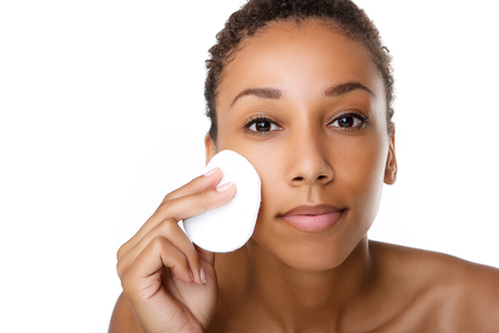 Photo for Close up portrait of a beautiful black woman removing make up - Royalty Free Image