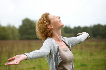 Photo pour Portrait of a happy middle aged woman enjoying life - image libre de droit