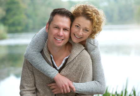 Photo for Close up portrait of a happy mature couple smiling outdoors - Royalty Free Image