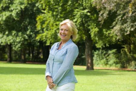 Foto per Portrait of a happy older woman smiling outdoors - Immagine Royalty Free